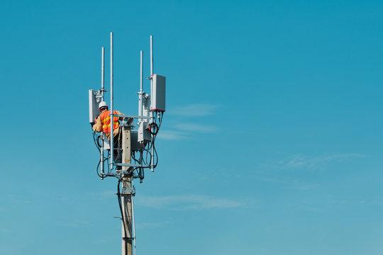 Technician on telecommunication antenna tower