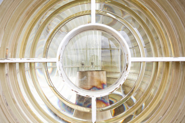 Look through glass and fressnel lenses on a lightbulb of a historical lighthouse in South Africa