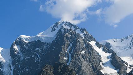 Rocky ridge under the snow. Mountain hiking, wilderness travel