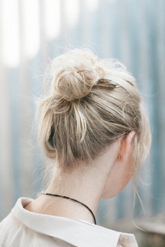 Portrait of a beautiful woman with a hair bun
