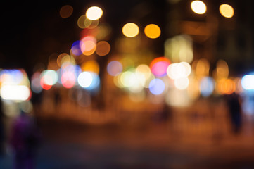 Blurred image of lights on a night street.