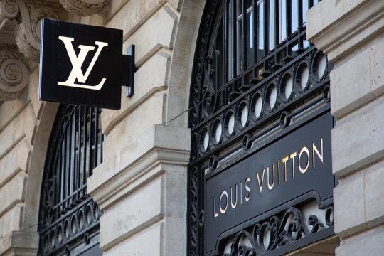 Louis Vuitton logo store sign Luxury brand shop handbags luggage