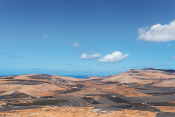 colorful scenic landscape on Lanzarote, Canary Islands, against ocean and blue sky