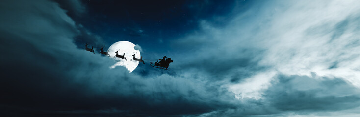 Santa Claus flying in his sleigh over the clouds