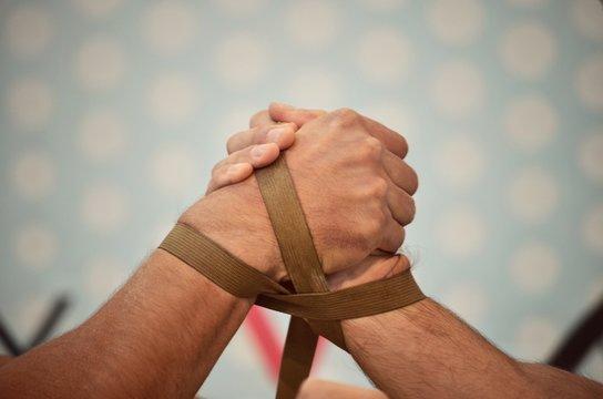 Participants of a tournament on Arm wrestling