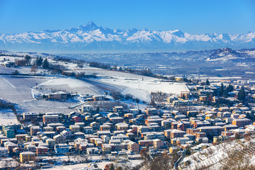 Small town and hills covered in snow in Italy.