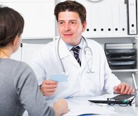 Doctor speaking with client in the medical center