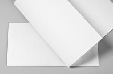 Blank Folded Sheet of Paper, Letterhead, or Flyer over Blank Envelope