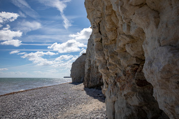 Rock on the beach - Landscape with sea and blue sky at the cliffs in Denmark