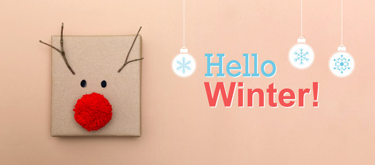 Hello winter message with a red nose reindeer gift box