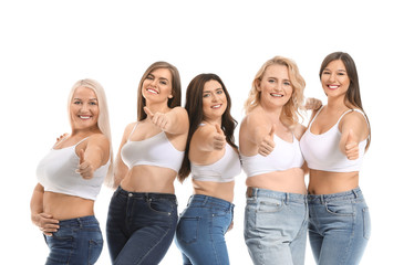 Group of body positive women showing thumb-up on white background