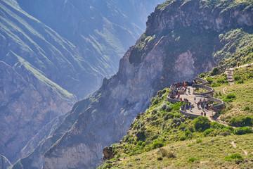 Tourists at the Cruz del Cóndor viewpoint, Colca Canyon, Peru