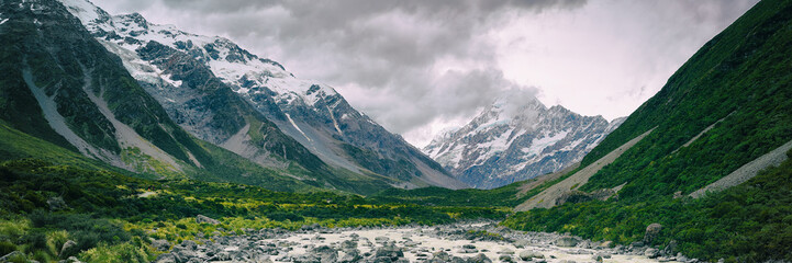 Hooker Valley Track hiking trail, New Zealand. View of Aoraki Mount Cook National Park with snow capped mountains. Banner panorama landscape.