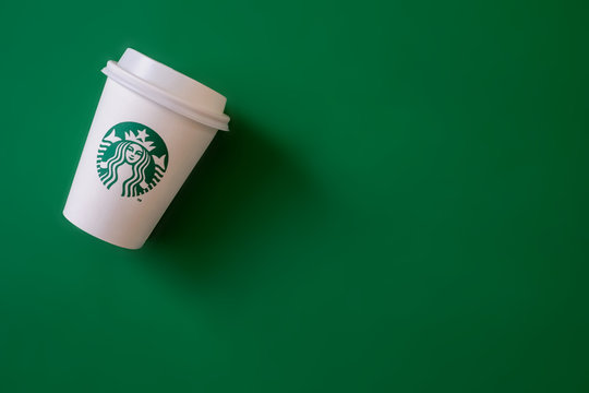 Bangkok ,Thailand - May 17 2019 : A cup of Starbucks coffee with logo isolated on Starbucks green background