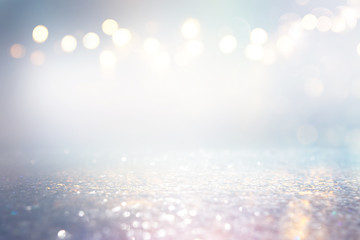 abstract background of glitter vintage lights . silver, gold and blue. de-focused