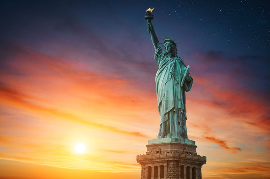 New York City, The Statue of Liberty in a colorful sunset.