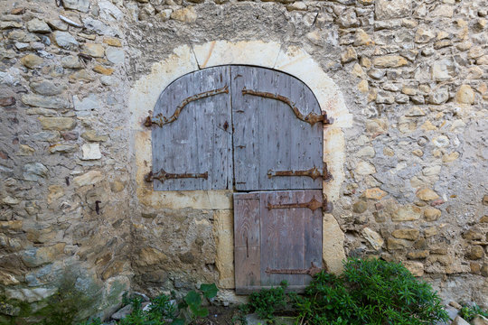 facade of a house in a medieval street of a village in Provence, France