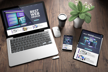Wall Mural - three devices on wooden desk top view best web design