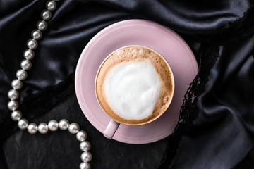 Cup of cappuccino for breakfast with satin and pearls jewellery background, organic coffee with lactose free milk in parisian cafe for luxury vintage holiday brand Wall mural
