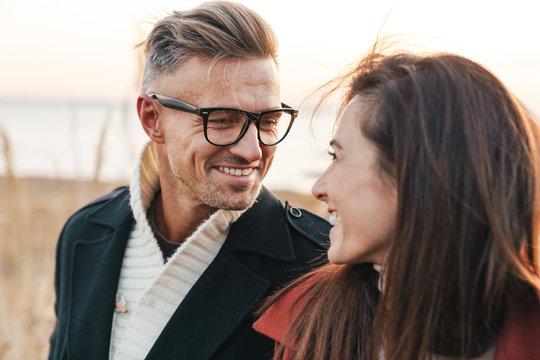Beautiful smiling couple wearing autumn clothing