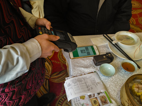 Zhongshan,China-February 1, 2018:doing payment at a restaurant via Wechat money on mobile.Wechat or Alipay for payment and money transfering via mobile becomes very common and popular in China