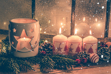 christmas candle and decorations on background 3. advent sunday