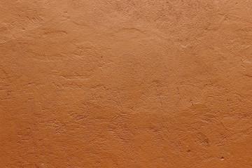 Foto auf Leinwand Steine Dark terracotta plaster rough wall texture background