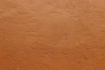 Dark terracotta plaster rough wall texture background Fototapete