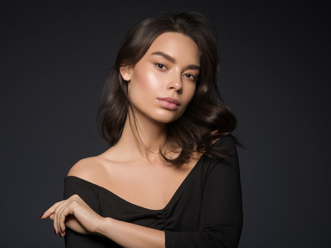 Beautiful asian woman black dress healthy skin natural makeup