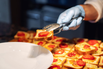 Chef serving canapes on plate service in restaurant