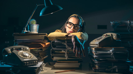 Businesswoman overloaded with paperwork