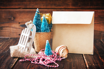 Artificial little Christmas treees in biodegradable peat moss, craft envelope, small sledge and wooden shavings. Eco-friendly New Year