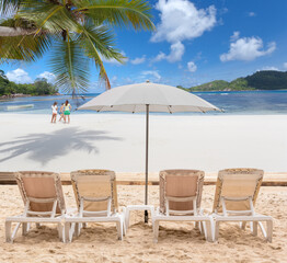 chairs and umbrella on the beach, Seychelles Islands