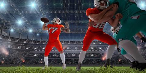 American football players in professional sport stadium.