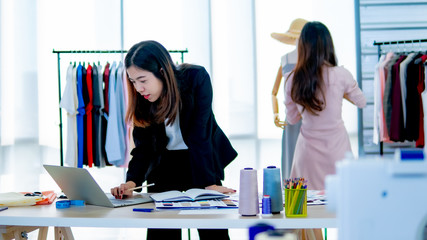 Two young designer working in garment industry