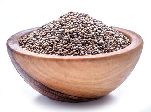 Heap of Chia seeds isolated on white background. Top view.