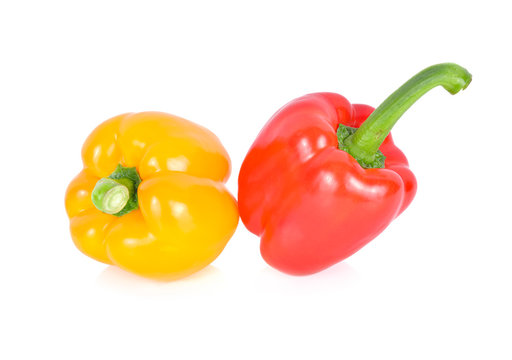whole fresh red and yellow bell pepper with stem on white background