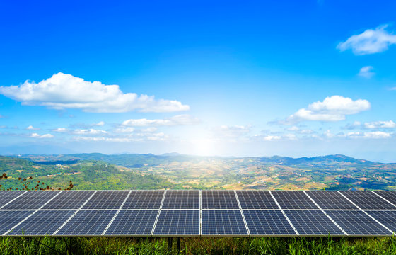 power solar panel on Forested Mountain blue sky background,alternative clean green energy concept