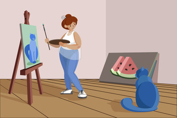 The girl paints a picture on canvas, standing at the easel. An artist with a palette and a brush in his hands. Body positive girl draws a cat in an art studio.