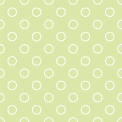 Seamless vector pattern with polka dots on fresh grass green background
