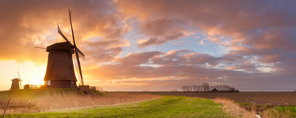 Printed kitchen splashbacks Sunset Traditional Dutch windmills at sunrise in The Netherlands