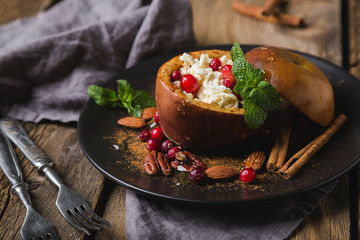 Baked apple with cottage cheese, berries and honey. Healthy dessert