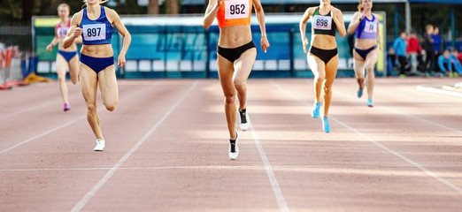 group women runners running race sprint track and field competition