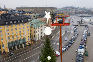 Ola Boden puts the finishing touches to the 35 meter high Christmas tree at Skeppsbron in Stockholm