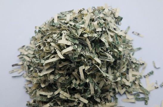 pile of shredded money or dollar bills