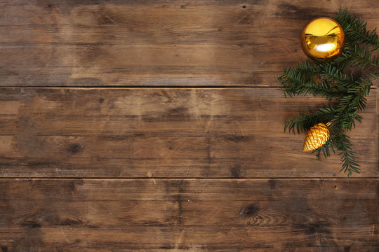 empty mock up in beautiful christmas composition with yellow christmas ball and pine cone on old wooden table, christmas tree branch, advent and christmas concept