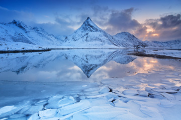 Wall Mural - Mountain reflected in a fjord in Norway in winter