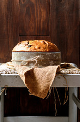 Panettone, typical christmas italian food, on rustic wooden background.