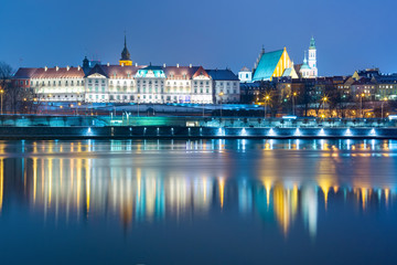 Aluminium Prints Eastern Europe Old Town with reflection in the Vistula River during evening blue hour, Warsaw, Poland.