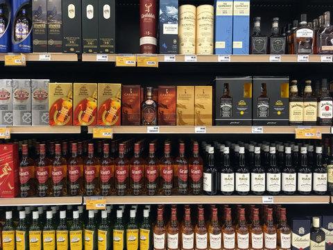 whisky and bourbon bottles at liquor store